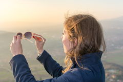 Girl on hiking trip enjoying the sunset view Royalty Free Stock Image