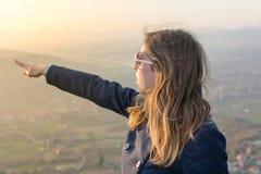 Girl on hiking trip enjoying the view Royalty Free Stock Photos