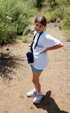 Girl hiking with water bottle. Girl smiling on trail royalty free stock image