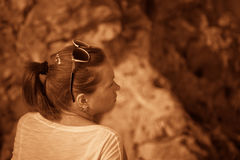 Girl on a hill in the desert. Ordinary people. Effect - Sepia. Stock Photo