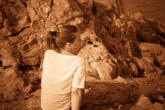 Girl on a hill in the desert. Ordinary people. Effect - Sepia. Stock Images