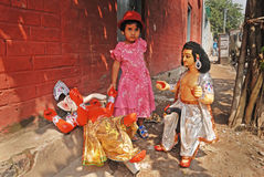 A girl & Hindu Idol. Stock Photography