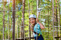 Girl on hinged trail in extreme rope Park Royalty Free Stock Photography