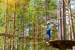 Girl on hinged trail in extreme rope Park Stock Photography