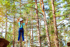 Girl on hinged trail in extreme rope Park Royalty Free Stock Image