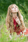 The girl of hippie in a grass Stock Images