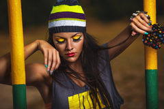 Girl hipste on sports ground Stock Photography