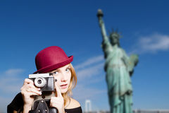 Girl in hipster glasses with camera on New York Royalty Free Stock Photography