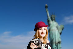 Girl in hipster glasses with camera on New York Stock Photos