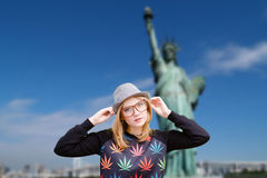 Girl in hipster glasses and hat on New York Stock Images