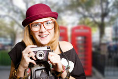 Girl in hipster glasses with vintage camera on UK Stock Images