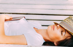 Girl hipster rests on a bench Stock Photo