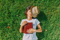 Girl hipster rests on the field Stock Images