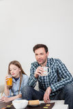 Girl with his father drinking juice Royalty Free Stock Images