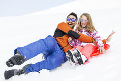 Girl and his father sledding very fast stock photos