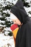 Girl in historical dress praying Stock Images