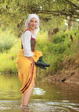 Girl in historical dress in water Stock Photography