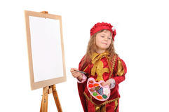 Girl in historical suit with a paintbrush Stock Image