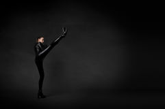 Girl hit with high kick Stock Images