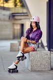 Girl hit the leg during roller skating Stock Photo
