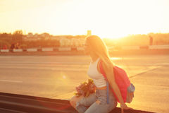 Girl hitchhiker Stock Photo
