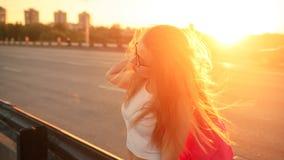 Girl hitchhiker Stock Image