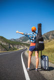 Girl hitchhiking Stock Images
