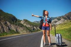 Girl hitchhiking Stock Photos