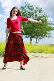 Girl hitchhiking on road Royalty Free Stock Images