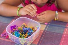 Making bracelet of loom bands Stock Photo