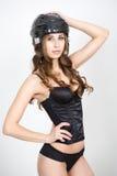 Girl in a hockey helmet. in underwear Stock Photography
