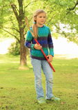 Girl with hockey stick Royalty Free Stock Photo