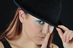 Girl hol finger near nose Stock Photography