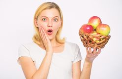 Girl hold basket apples white background. Metabolism and dieting. Healthy nutrition concept. Woman know how stay in. Shape and be healthy. Take advantage of stock photos