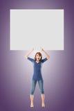 Girl hold a blank board Stock Photo