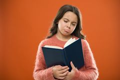 Girl hold book read story over orange background. Child enjoy reading book. Book store concept. Wonderful free childrens. Books available to read. Childrens stock images