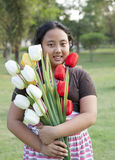 Girl hold bouquet of tulip flowers standing in ther garden Stock Images