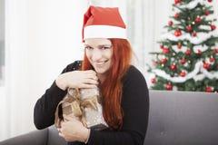 Girl hold christmas presentand keep it Royalty Free Stock Photos