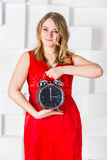 The girl hold a clock Stock Photography