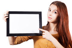 Girl hold empty frame. Beautiful girl hold empty frame and point on it with finger Stock Images