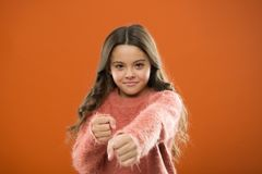 Girl hold fists ready attack or defend. Girl child cute but strong. Self defense for kids. Defend Innocence. How teach. Kids to defend themselves. Self defense royalty free stock photo