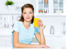 Girl hold a glass of fresh orange juice Royalty Free Stock Image