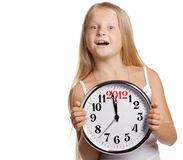 Girl hold in hands a clock with figures 2012 Royalty Free Stock Images