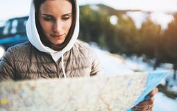 Girl hold in hands looking on map, people planning trip in snow mountain, relax tourist travels by auto car, hipster enjoy winter. Nature, journey landscape royalty free stock image
