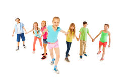 Girl hold hands with many friends and pull forward. With strength, isolated on white Royalty Free Stock Photo
