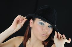 Girl hold on the hat Stock Images