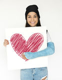 Girl hold a heart drawing on paper stock photo