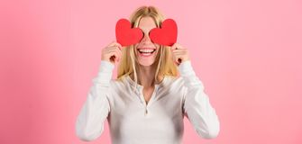 Girl hold heart symbol love and romantic pink background. Woman celebrate love. Girl cheerful fall in love. Love is. Blind. Valentines day has traditionally royalty free stock images