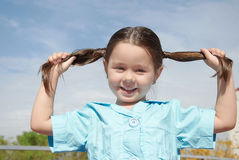 Girl hold her hair in hands Royalty Free Stock Images