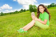 Girl hold jar with butterfly Royalty Free Stock Photography